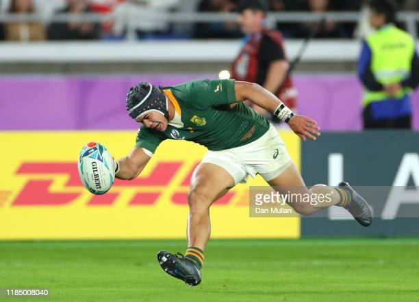 Cheslin Kolbe of South Africa touches down for their second try during the Rugby World Cup 2019 Final between England and South Africa at...