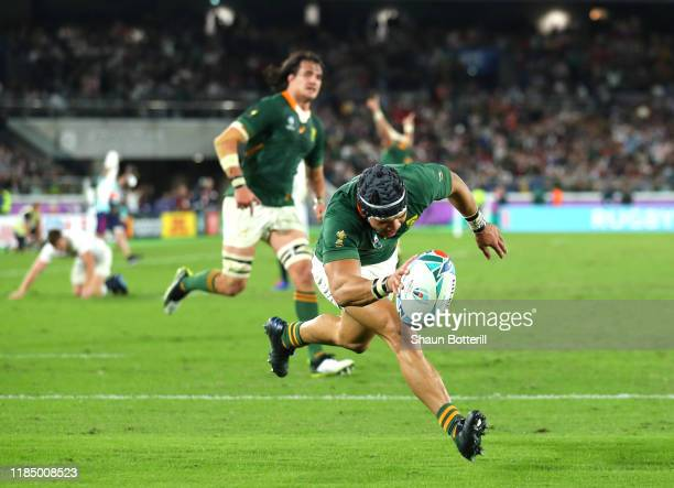 Cheslin Kolbe of South Africa touches down to score his team's second try during the Rugby World Cup 2019 Final between England and South Africa at...