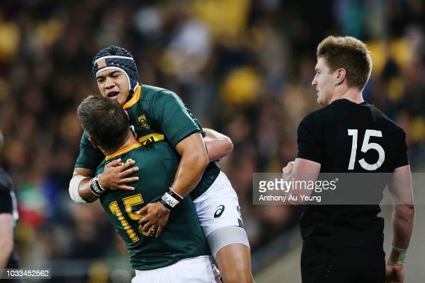 Cheslin Kolbe of the Springboks celebrates with teammate Willie le Roux after scoring a try during The Rugby Championship match between the New...