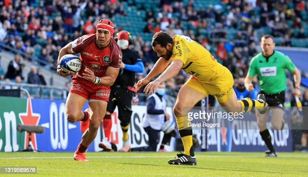 Cheslin Kolbe of Toulouse is tackled by Geoffrey Doumayrou during the Heineken Champions Cup Final match between La Rochelle and Toulouse at...