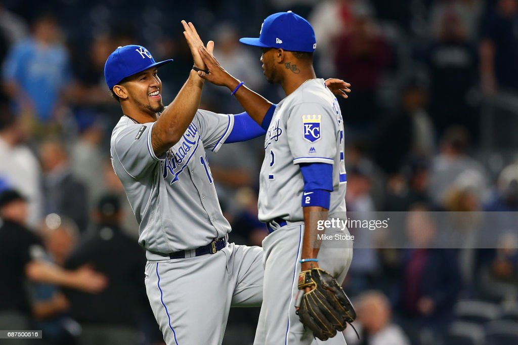 Cheslor Cuthbert #19 and Alcides Escobar #2 of the Kansas City Royals celebrate after defeating the New York Yankees 6-2 at Yankee Stadium on May 23, 2017 in the Bronx borough of New York City.