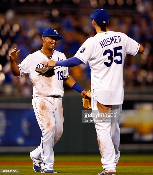 Cheslor Cuthbert and Eric Hosmer of the Kansas City Royals celebrate after the Royals defeated the Detroit Tigers 15-7 to win the game against the...