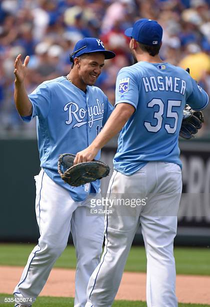 Cheslor Cuthbert and Eric Hosmer of the Kansas City Royals celebrate a 5-4 win over the Chicago White Sox at Kauffman Stadium on May 29, 2016 in...