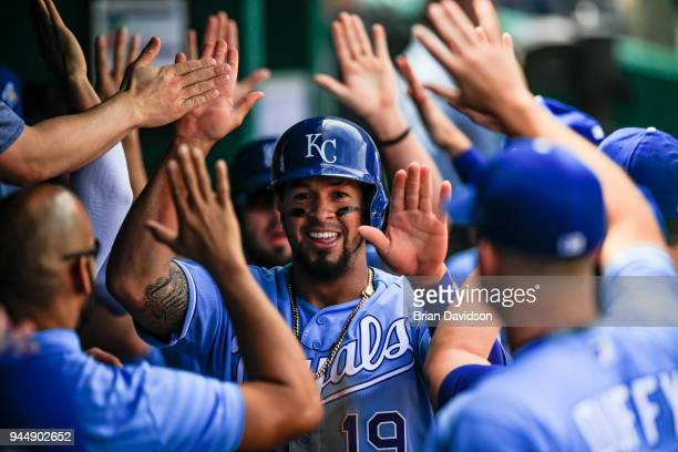 Cheslor Cuthbert of the Kansas City Royals celebrates in the dugout after scoring a run in the fourth inning against the Seattle Mariners at Kauffman...