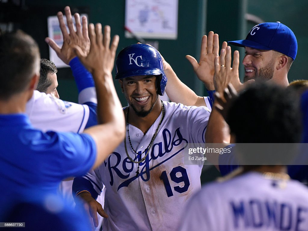 Cheslor Cuthbert #19 of the Kansas City Royals celebrates with teammates after scoring on a Eric Hosmer #35 single in the sixth inning at Kauffman Stadium on August 11, 2016 in Kansas City, Missouri.