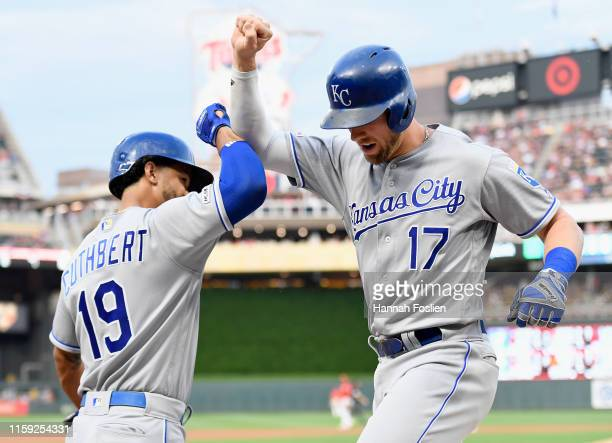 Cheslor Cuthbert of the Kansas City Royals congratulates teammate Hunter Dozier on a solo home run against the Minnesota Twins during the fourth...
