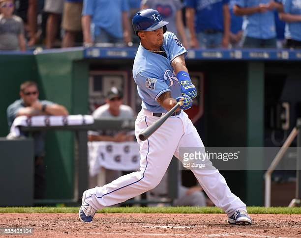 Cheslor Cuthbert of the Kansas City Royals hits an RBI single in the eighth inning against the Chicago White Sox at Kauffman Stadium on May 29, 2016...