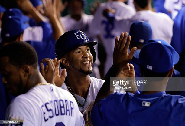 Cheslor Cuthbert of the Kansas City Royals is congratulated by teammates after scoring during the 8th inning of the game against the Seattle Mariners...