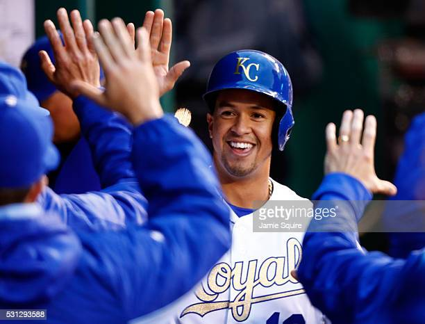 Cheslor Cuthbert of the Kansas City Royals is congratulated by teammates in the dugout after scoring during the 2nd inning of the game against the...
