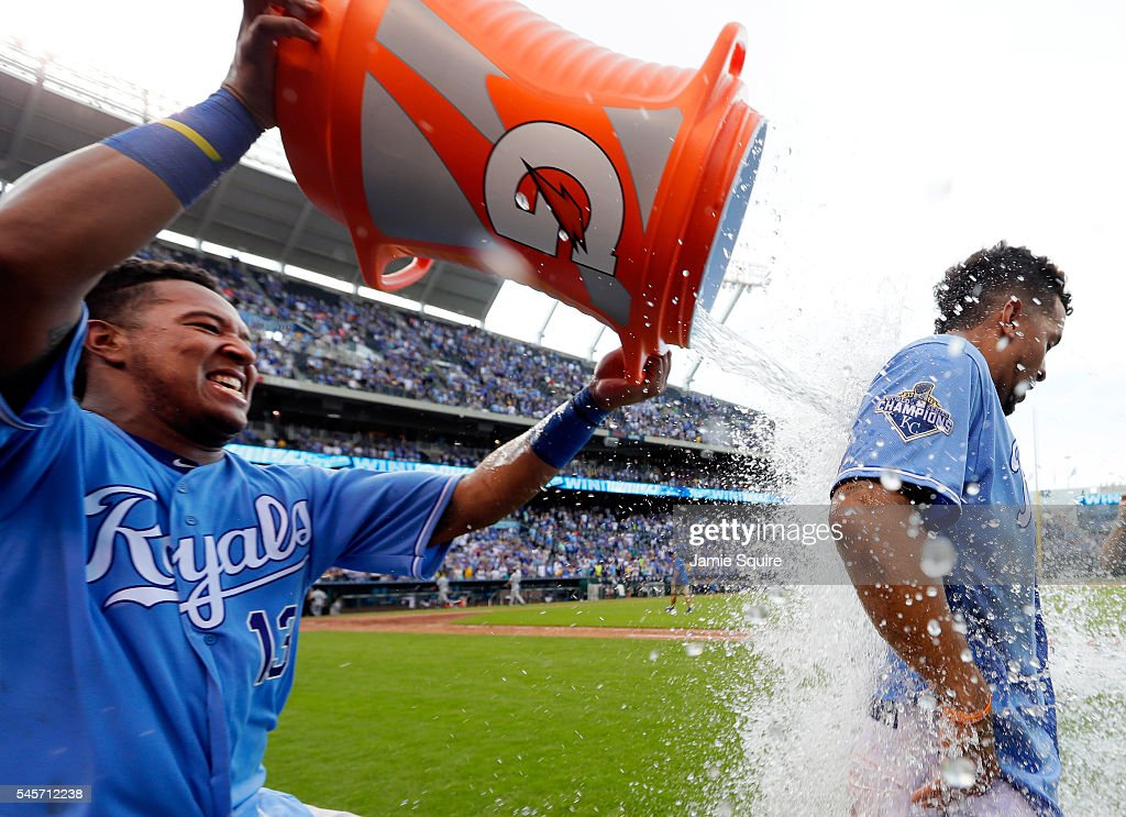 Cheslor Cuthbert #19 of the Kansas City Royals is doused with a bucket of water by catcher Salvador Perez #13 after the Roylas defeated the Seattle Mariners 5-3 to win the game at Kauffman Stadium on July 9, 2016 in Kansas City, Missouri.