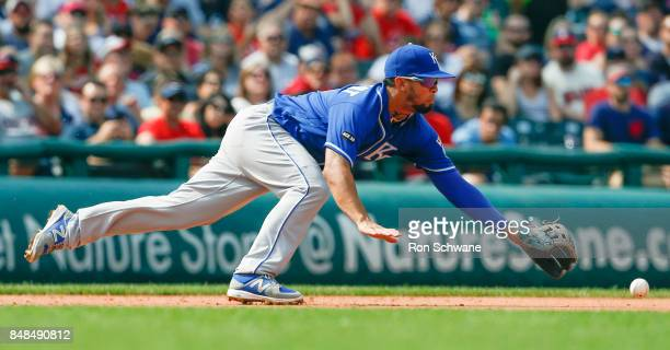 Cheslor Cuthbert of the Kansas City Royals makes a diving attempt on a single by Austin Jackson of the Cleveland Indians during the sixth inning at...