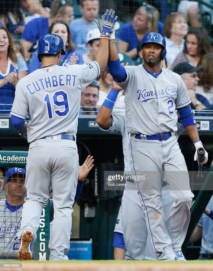 Cheslor Cuthbert #19 of the Kansas City Royals receives a high five from Alcides Escobar #2 after hitting a home run in the fifth inning against the Houston Astros at Minute Maid Park on April 8, 2017 in Houston, Texas.