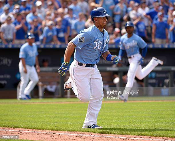 Cheslor Cuthbert of the Kansas City Royals runs out an RBI single as Jarrod Dyson of the runs home to score in the eighth inning against the Chicago...