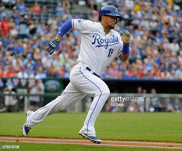 Cheslor Cuthbert of the Kansas City Royals runs to first after hitting a double in the first inning against the Texas Rangers at Kauffman Stadium on...