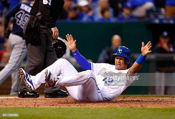 Cheslor Cuthbert of the Kansas City Royals slides safely into home to score during the 2nd inning of the game against the Atlanta Braves on May 13...