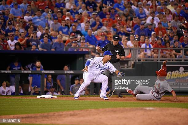 Cheslor Cuthbert of the Kansas City Royals tags out Aledmys Diaz of the St. Louis Cardinals as he tries to steal third at Kauffman Stadium on June...