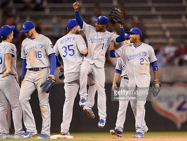 Cheslor Cuthbert, Paulo Orlando, Eric Hosmer, Jarrod Dyson and Alcides Escobar of the Kansas City Royals celebrate a win of the game against the...