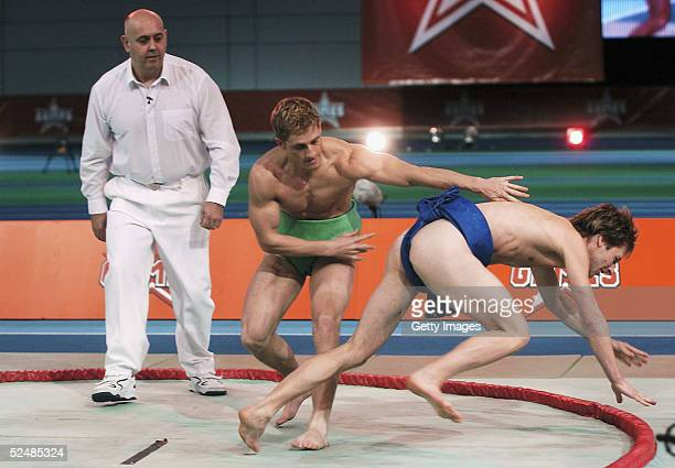Chesney Hawkes and Philip Olivier of the boys participates in the sumo wrestling tournament on day three of the new series of the reality TV show The...