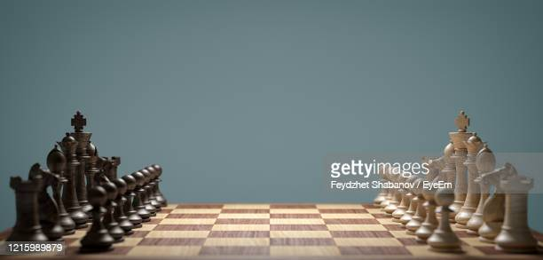chess board against wall - chess stock pictures, royalty-free photos & images