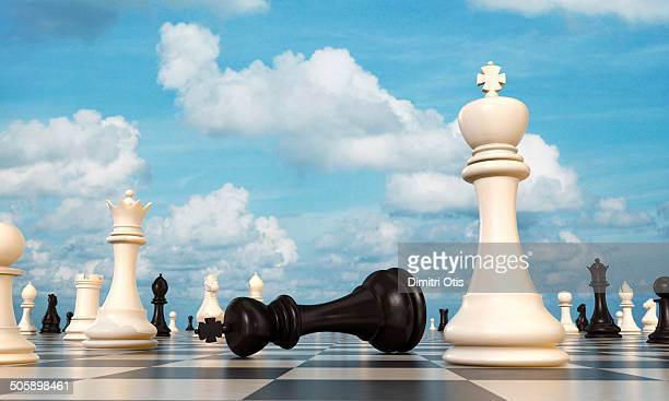chess board, black king lying beside white king - chess stock pictures, royalty-free photos & images
