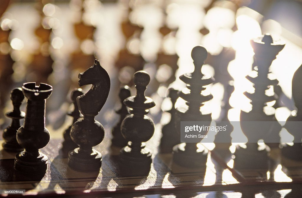 Chess board with pieces, close up : Stockfoto