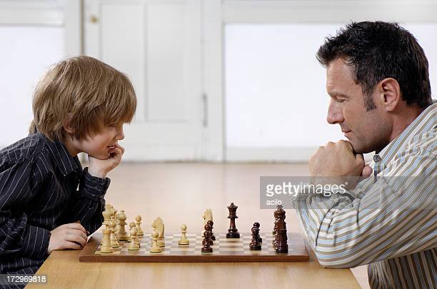 A chess competition between a father and his young son