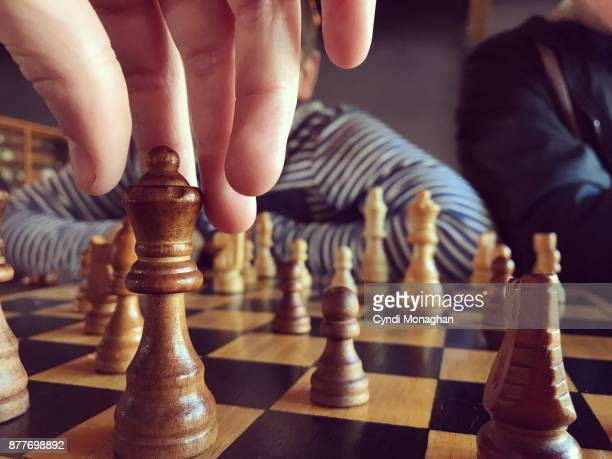 chess game with her little brother - chess stock pictures, royalty-free photos & images