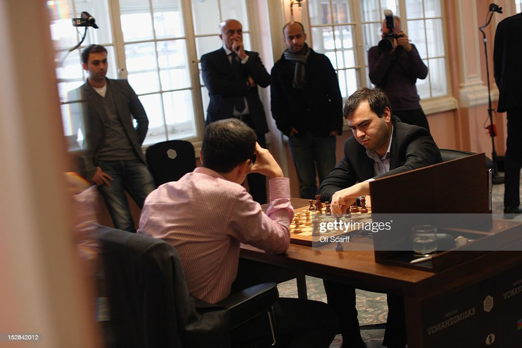 Chess Grandmasters Shakhriyar Mamedyarov (2nd R) and Rustam Kasimdzhanov (2nd L) play in round 6 of the World Chess London Grand Prix at Simpson's-in-the-Strand on September 27, 2012 in London, England. The event, which begins the 2012/13 World Chess Championship Cycle, runs until October 3, 2012 and takes place over 11 rounds. The London Grand Prix is the first tournament in an ambitious, high-profile rebranding of world chess by American-born entrepreneur Andrew Paulson whose intention is to regain the global popularity chess enjoyed in the 1970s with matches between American Bobby Fischer and the Soviet Union's Boris Spassky.
