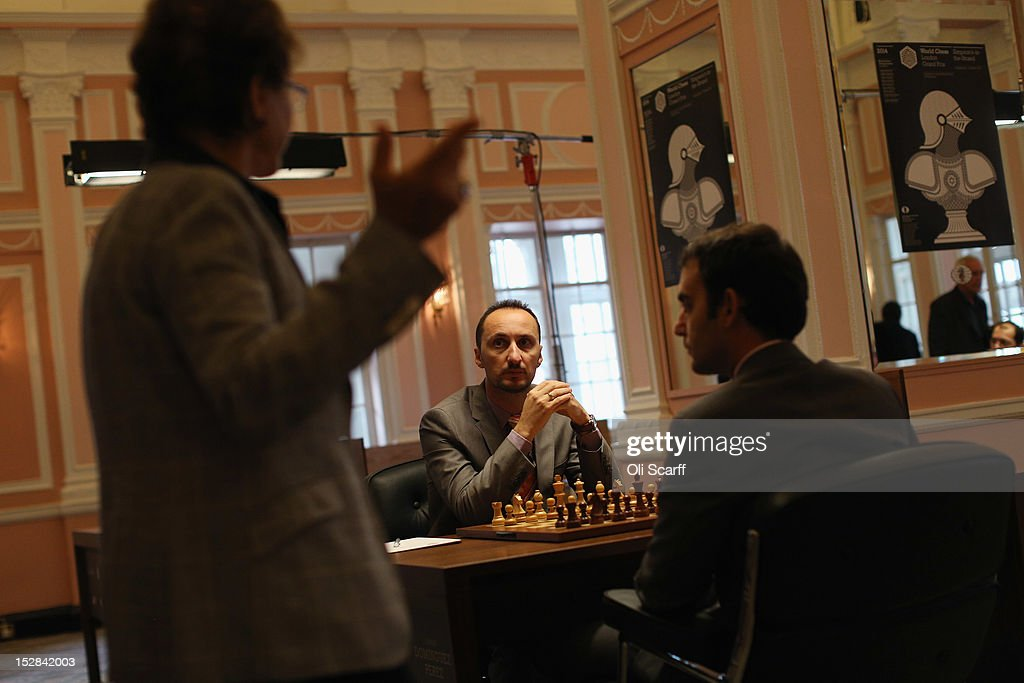Chess Grandmasters Veselin Topalov (C) and Leinier Dominguez Perez (R) prepare to play in round 6 of the World Chess London Grand Prix at Simpson's-in-the-Strand on September 27, 2012 in London, England. The event, which begins the 2012/13 World Chess Championship Cycle, runs until October 3, 2012 and takes place over 11 rounds. The London Grand Prix is the first tournament in an ambitious, high-profile rebranding of world chess by American-born entrepreneur Andrew Paulson whose intention is to regain the global popularity chess enjoyed in the 1970s with matches between American Bobby Fischer and the Soviet Union's Boris Spassky.