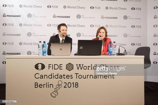 Chess grandmasters Yannick Pelletier and Judit Polgar is seen at the First Move Ceremony during the World Chess Tournament on March 10, 2018 in...