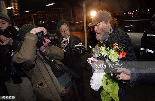 Chess legend Bobby Fischer is welcomed by the press upon arrival in Reykjavik late 24 March 2005 The highly controversial former world champion who...