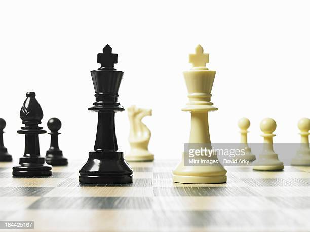 Chess pieces on a board in a game.