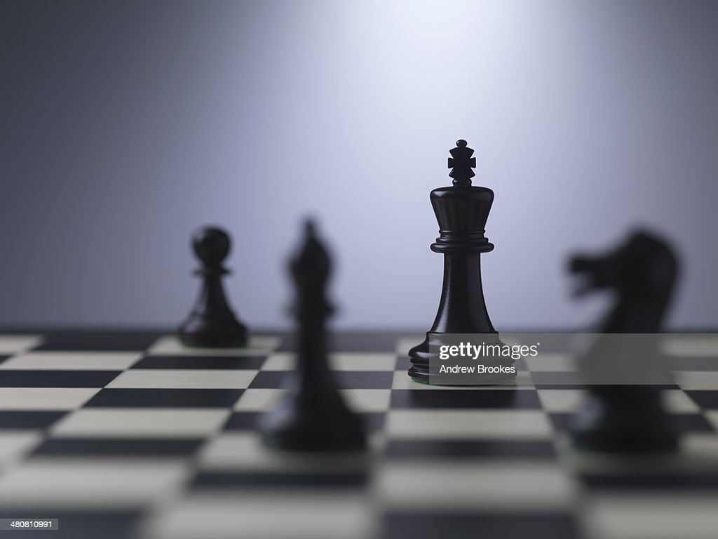 Chess pieces on a board showing king : Stock Photo