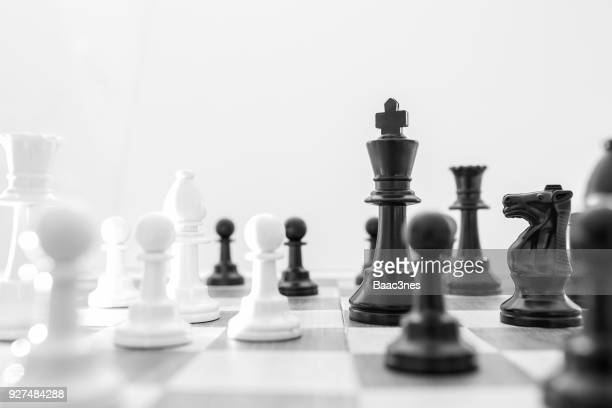 chess pieces on a chess board - chess stock pictures, royalty-free photos & images