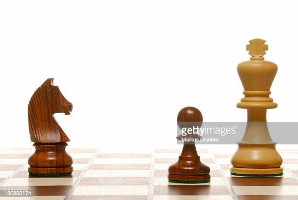 Chess pieces on a chess board, symbolic of strategy