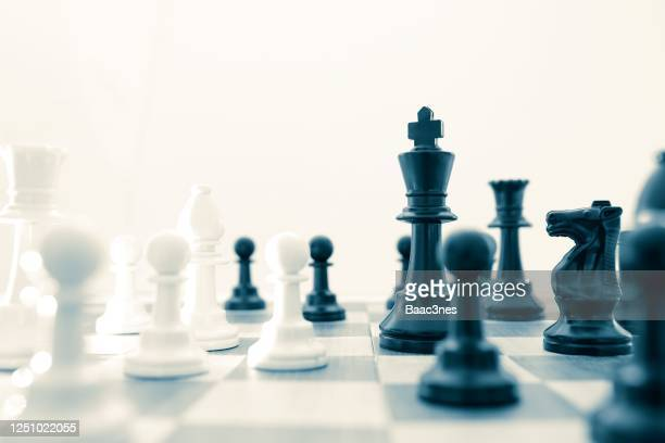 chess pieces on a chessboard - chess stock pictures, royalty-free photos & images