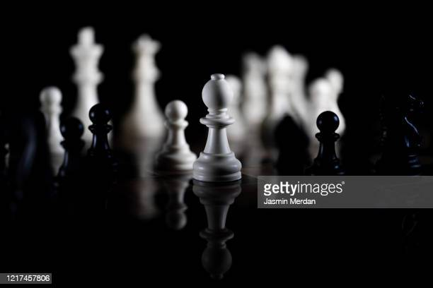 chess pieces on black background - chess stock pictures, royalty-free photos & images