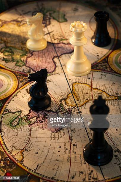 Chess pieces on old world map