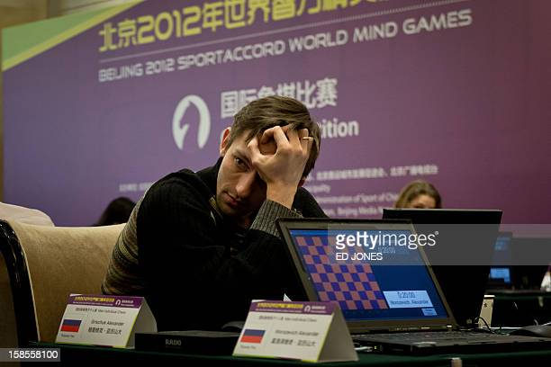 Chess player Alexander Grischuk of Russia prepares to compete in a 'blinfold' chess tournament at the Beijing 2012 World Mind Games Tournament in...