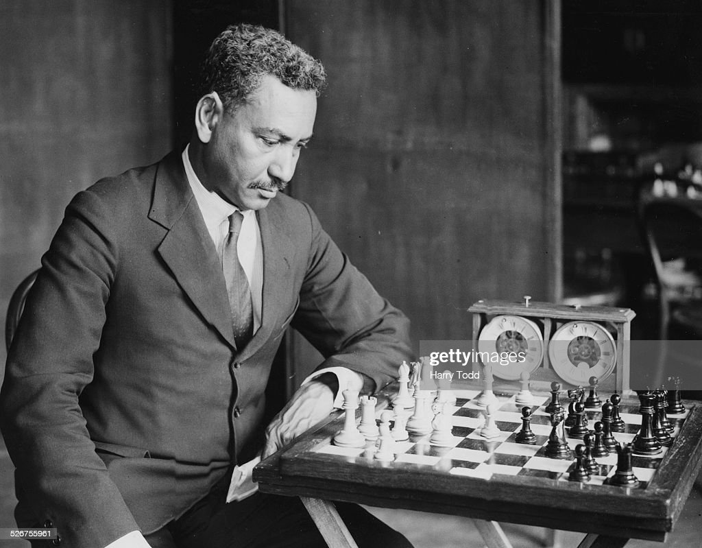 Chess player J A M Osborn, from British Guiana, playing a game at the annual chess tournament of the British Chess Federation, Yarmouth, England, July 11th 1935.