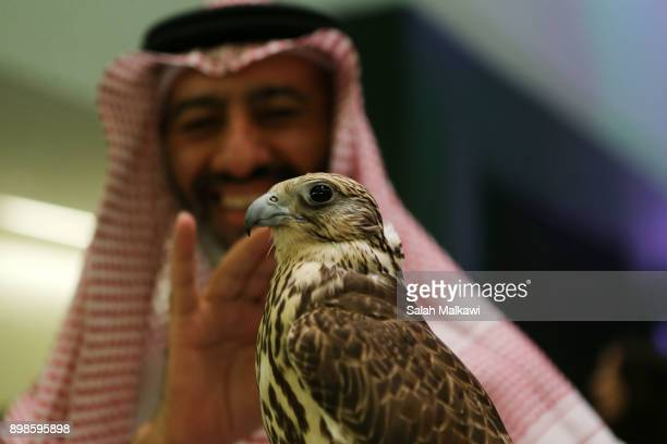 Chess players enjoy their time with a falcon on the spot as they attend the King Salman Rapid Blitz Chess Championships opening in Riyadh Saudi...