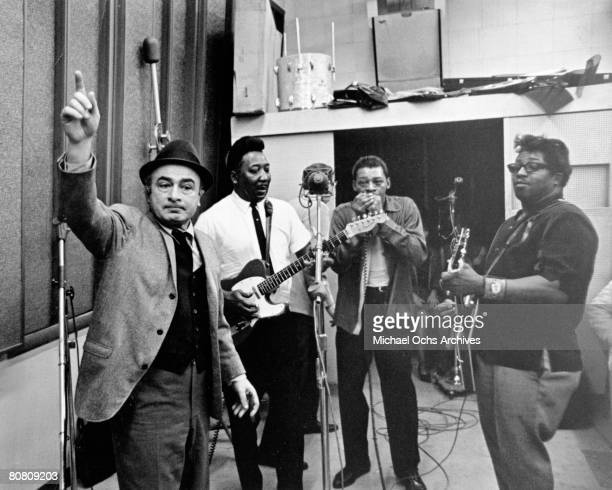 Chess Records cofounder Phil Chess supervises the recording of Chess artists LR Muddy Waters Little Walter and Bo Diddley as they record the album...