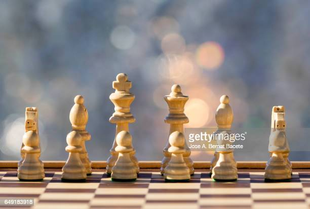 Chessboard on a table illuminated by the light of the Sun outdoors