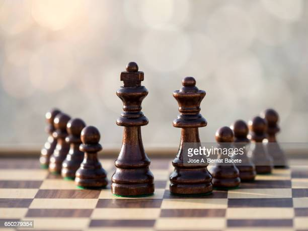chessboard on a table illuminated by the light of the sun outdoors - imperial system stock photos and pictures