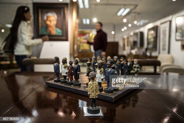 A chessboard showing black members of South Africa's postapartheid government including late President Nelson Mandela as the the king figurine and...