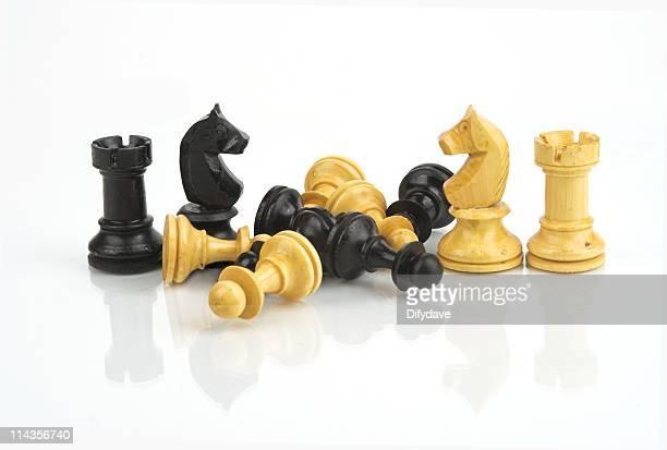 Chessmen Doing Battle On Glass Background