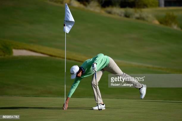 Chesson Hadley picks up his ball after making eagle on the 15th hole during the second round of the Shriners Hospitals For Children Open at the TPC...