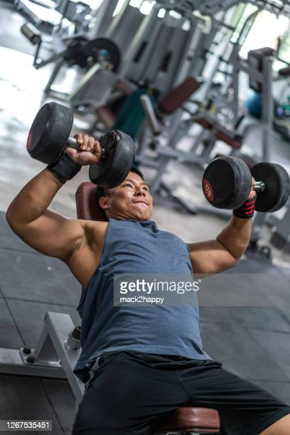 chest day - skinhead stock pictures, royalty-free photos & images
