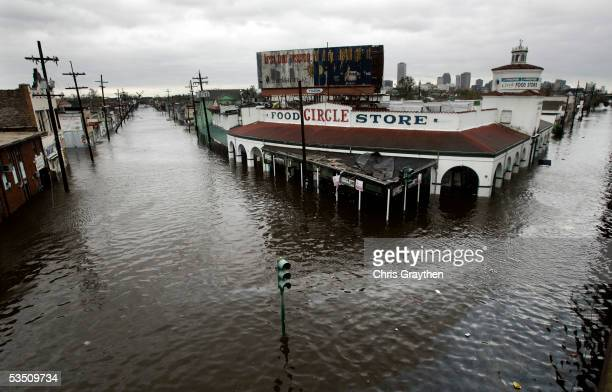 Chest deep water dumped from hurricane Hurricane Katrina collects in the street late Monday afternoon on August 29 2005 in New Orleans Louisiana...