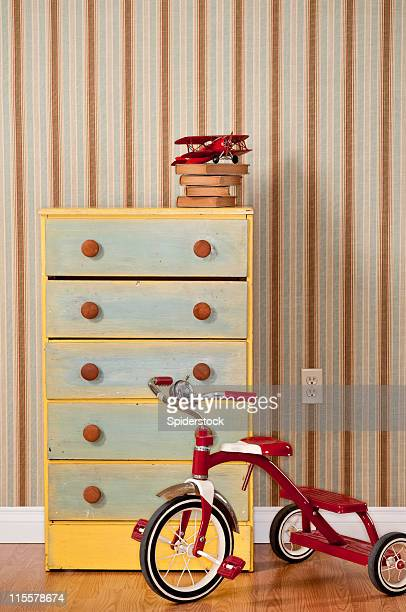Chest Of Drawers With Red Tricycle